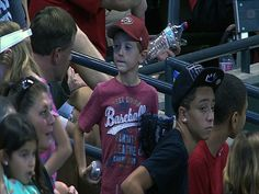 VIDEO: 9/1/13: One young fan is upset he didn't get a foul ball, so another gives him his store-bought souvenir and is rewarded for his generosity