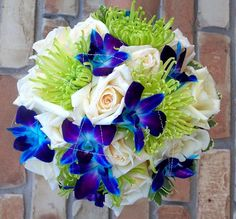 Pretty blue orchids mixed with lime green flowers