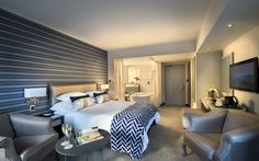 Guest room at The PortsWood Hotel, on the Victoria and Albert Waterfront in Cape Town, originally built as part of the convict's station. Hotels And Resorts, Best Hotels, Hotel Amenities, Boutique Design, Hotel Reviews, Cape Town, Room Interior, Guest Room, Victoria