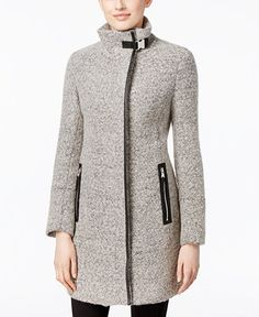 Calvin Klein Faux-Leather-Trim Boucle Walker Coat... overall a great look but the faux leather accents do come off a bit cheap. Also sheds like the dickens!