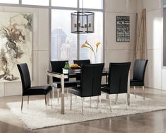 "With sleek straight-line tubular metal table bases covered in a brushed nickel finish supporting stylish printed tempered glass table tops, the ""Baraga"" dining collection perfectly captures the excitement and artistic beauty of refreshing Metro Modern designed furniture. For more information email ashley@ashleyhomestoretx.com."
