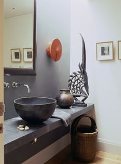 Cultured Home --- Orange Zulu hat wall mounted in a bathroom by Hare + Klein