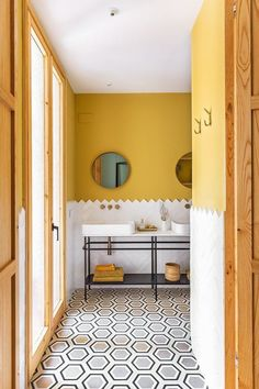 Yellow bathroom and graphic b-and-w tiles