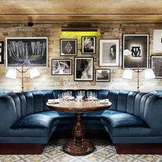 Little House - Mayfair, UK. ....I♥this plush royal blue seating in the dining room, whitewashed exposed brick walls