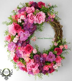 This Large Floral Wreath is just beautiful, it would look gorgeous on Your door! It measures 24 x 22 x 8. Full of spring florals accented with complimentary wired ribbon and greenery and shown on a 18 grapevine wreath. This would make a wonderful gift. Also, perfect for your