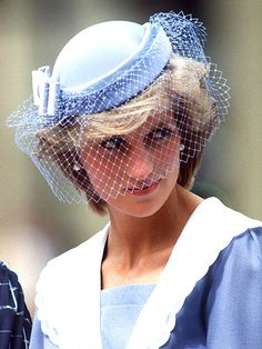 People: PERIWINKLE PEEKABOO photo | She covered up her baby blues with a similarly colored veil during a 1983 visit to Canada. Credit: Tim Graham/AP