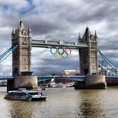 The Olympic rings and Tower Bridge: only 26 days until opening ceremony. London, England.  Photo: Tennis by Lisa