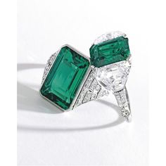 FROM THE ESTATE OF HELEN HAY WHITNEY: A PAIR OF EMERALD RINGS: Including A Platinum, Emerald and Diamond Ring, Tiffany & Co. Centering an emerald-cut emerald, accented by old European-cut diamonds ~ .50 carat; circa 1925.