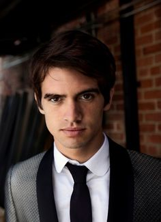 Brendon Urie......he kind of looks like Topher Grace but it's not....it's Brendon Urie!