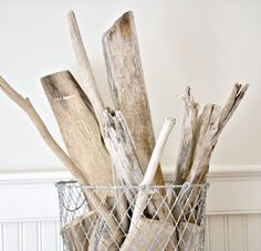 Driftwood in a wire basket would be an interesting design element