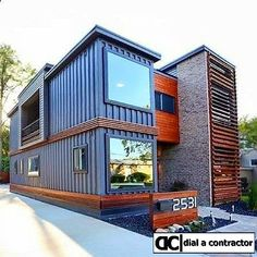 How beautiful is this sea container home? Sleek design balanced with natural wood and clean lines. We love repurposed sea containers!