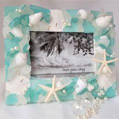 Artisan handmade sea glass frame in Aqua, perfect coastal decor seashell and beach glass frame for beach gifts, coastal gifts, beach wedding gifts. Seashell Frame, Beach Frame, Starfish, Beach Wedding Gifts, Beach Gifts, Aqua, Glass Picture Frames, Sea Glass Colors, Shell Crafts