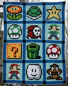 Super Mario quilt made up of nearly 4,000 little blocks of fabric.