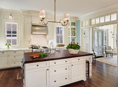 Traditional Kitchen by Charleston General Contractors Structures Building Company