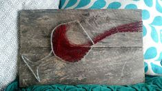 This fun ode to wine features a wine glass and string manipulation so there is a real fluid aspect to it! Can do any colors and can customize to include a phrase or name at the bottom! All art comes ready to hang on distressed wood.