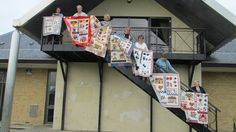 Seven of us with our different versions of a Country Quilt design by Sue - in the middle in sunglasses.