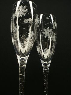 Floating Flakes . Two Hand Engraved Champagne Flutes . Engraved Glass . Holiday Stemware . Winter Weddings. $60.00, via Etsy.