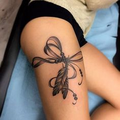 feather tattoo on thigh #TattooYou #FeatherTattooIdeas
