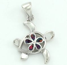 This delicate sea turtle pendant features a flower design in opal inlays. This sterling silver necklace makes a charming choice to accessorize your outfit. PENDANT DETAILS - Pendant length: 1.9 cm - C