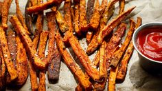 "These addictive seasoned ""fries"" from Mark Bittman are actually baked, but we promise you won't miss the grease The spice mix – garlic powder, paprika, salt and black pepper – can be used on regular potatoes as well (you'll just need to increase the baking time a bit)."