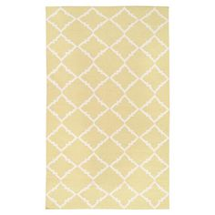 Bring eye-catching style to your living room or master suite with this hand-woven wool rug, showcasing a quatrefoil-inspired trellis motif in tarragon.