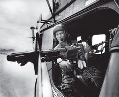 Larry Burrows—Time & Life Pictures/Getty Images  Lance Cpl. James C. Farley, helicopter crew chief, Vietnam, 1965.