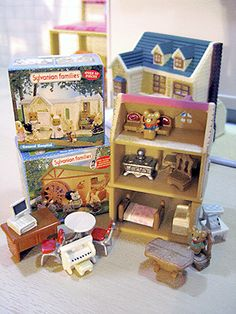 Miniature Orchard Cottage (my favourite house in the Toy Shop set) and St. Francis school together make a great three floor dollhouse.