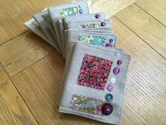 Needle case using liberty fabric and buttons Needle Case, Liberty Fabric, Fabric Scraps, Book Covers, Coin Purse, Cases, Buttons, Coin Purses, Cover Books