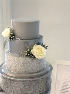 Silver grey wedding cake with fresh flowers. Perfect for your Christmas wedding, sparkly glitter tier and a silver satin tier, finished off with beautiful fresh Christmas flowers. Sparkly Wedding Cakes, 2 Tier Wedding Cakes, Christmas Wedding Cakes, Christmas Flowers, Elegant Wedding Cakes, Wedding Cake Designs, Wedding Cake Toppers, Elegant Cakes, Wedding Ideas