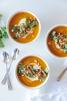 Carrot ginger soup with crispy shallots and coconut cream. A healthy soup that's gluten-free and dairy-free. www.downshiftology.com