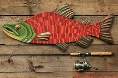 "Sometimes known as the ""Red Salmon"" or ""Humpbacks"", this salmon painting depicts a mature Sockeye Salmon male in full spawning colors. He wears a long green snout, pronounced hooked jaw, and displays"