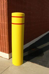 A plastic bollard by Reliance Foundry is shown against the corner of a building where has been installed protect the wall. Access Control, Pittsburgh, Corner, Plastic, Building, Wall, Buildings, Walls, Construction