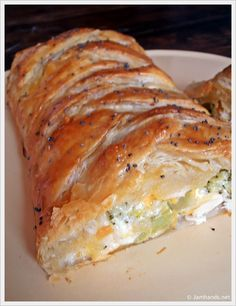 Broccoli Cheddar Chicken Braid  Makes one large or two medium braids   2 cans Pillsbury Original Crescent Rolls  2 cups diced-cooked chicken,  2 cups cheddar cheese  2 cups frozen broccoli,steamed and chopped  ½ cup mayonnaise  1 egg yolk,  poppy seeds