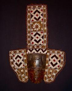 Kuba Mask of wood, glass beads, & cowrie shells.