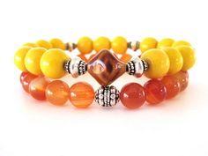Bright and sunny beaded stretch bracelets featuring 10mm yellow limestone beads, 8mm carnelian beads, a vintage glass focal bead and pewter accent beads. The perfect bracelet set for your spring and summer outfits! Wear stacked as show, individually for a simple statement look, or stacked with other colorful Rock & Hardware bracelets for a fun arm party.