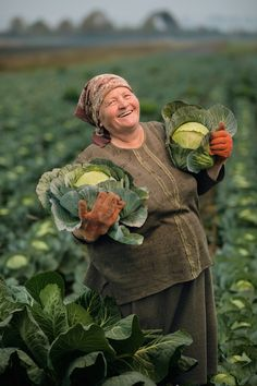 Picture of Olexandra Salo, Hlynske, Ukraine, holding cabbage in a field. National Geographic Feeding the World
