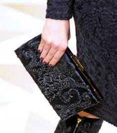 755753517125b Salvattore Ferragamo - the perfect black clutch.