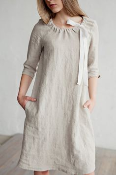Beautifully draping knee-length linen dress with sleeves. This linen womens dress features side pockets and a drawstring neckline with a white ribbon inside. Soft, lightweight, and comfortable midi dress CAMBRIA is perfect Linen Dresses, Cotton Dresses, Women's Dresses, Casual Dresses, Fashion Dresses, Summer Dresses, Fashion Clothes, Dress Neck Designs, Designs For Dresses