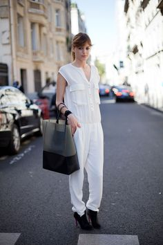 STREET STYLE SPRING 2013: PARIS FASHION WEEK - A white jumpsuit and easy black tote from Celine makes for a cool mix.