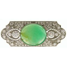 1920s Art Deco Carved Jade Diamond Gold Platinum Pin Brooch | From a unique collection of vintage brooches at https://www.1stdibs.com/jewelry/brooches/brooches/