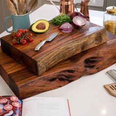 The Live Edge Collection Pyman Chopping board is made from Indian acacia wood creating charm and character, this range helps you to bring a feel of the outdoors in by creating a minimal and earthy look. The simplicity of these designs are what makes them so impressive, this chopping board is a slab of wood at 8cm thick creating a natural look. The live edge feature brings an eye catching design to these pieces and highlights the handmade beauty and authenticity of these products. Be sure to take Chopping Boards, Cutting Boards, Butcher Block Cutting Board, Live Edge Furniture, Live Edge Wood, Live Edge Table, Donia, Hill Interiors