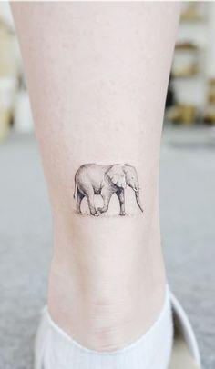 elephant tattoos with flowers . elephant tattoos meaning . elephant tattoos for women . Simple Elephant Tattoo, Elephant Tattoo Meaning, Elephant Tattoo Design, Elephant Tattoos, Animal Tattoos, Realistic Elephant Tattoo, Elephant Family Tattoo, Elephant Elephant, Small Elephant