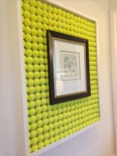 DIY picture frame made of tennis balls.