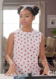 Zoey's strawberry print top on Black-ish. Outfit Details: https://wornontv.net/64553/ #Blackish