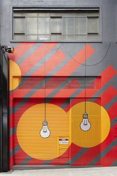 """Old Power Station Gets New Graphics at Melbourne's """"Upper West Side"""" Upper West Side shopping Melbourne Mimi Design Studio. Fray: I really like how this facade is because of the drawing of the light bulbs it seems very original. Graphic Design Agency, Environmental Graphic Design, Environmental Graphics, Upper West Side, Mural Art, Wall Murals, Foto Poster, Signage Design, Street Art Graffiti"""