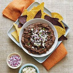 Black Bean Dip with Olive Oil, Diced Onion, Chili Powder, Ground Cumin, Fresh Lime Juice, Water, Fresh Oregano, Chipotle Chile, Salt, Black Beans, Queso Fresco, Red Onion, Chopped Fresh Cilantro, Corn Chips. Appetizer Dips, Appetizer Recipes, Snack Recipes, Cooking Recipes, Vegetarian Recipes, Black Bean Dip, Black Beans, Baked Pita Chips, Bean Dip Recipes