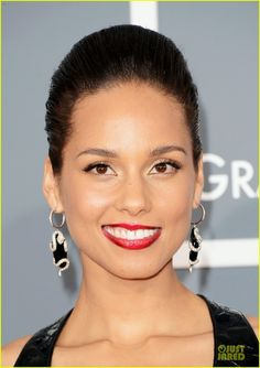 Alicia Keys & Swizz Beatz - Grammys 2013 Red Carpet in snake earrings and black and white trend.