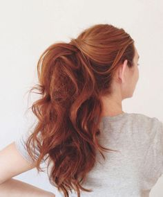 A Teased Ponytail: Make your pony a conversation starter by teasing, curling, and adding about a half a can of hairspray.