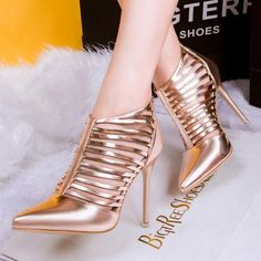 - Trendy cage point toe ankle high heels for the stylish fashionista - Trendy design offers a unique stylish look - Perfect for special occasions or parties - Made from PU - 9 cm heel height - Availab