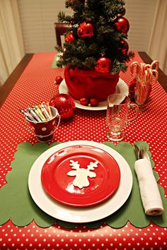 Several really easy and yet elegant holiday table settings...this table is geared toward the kids!